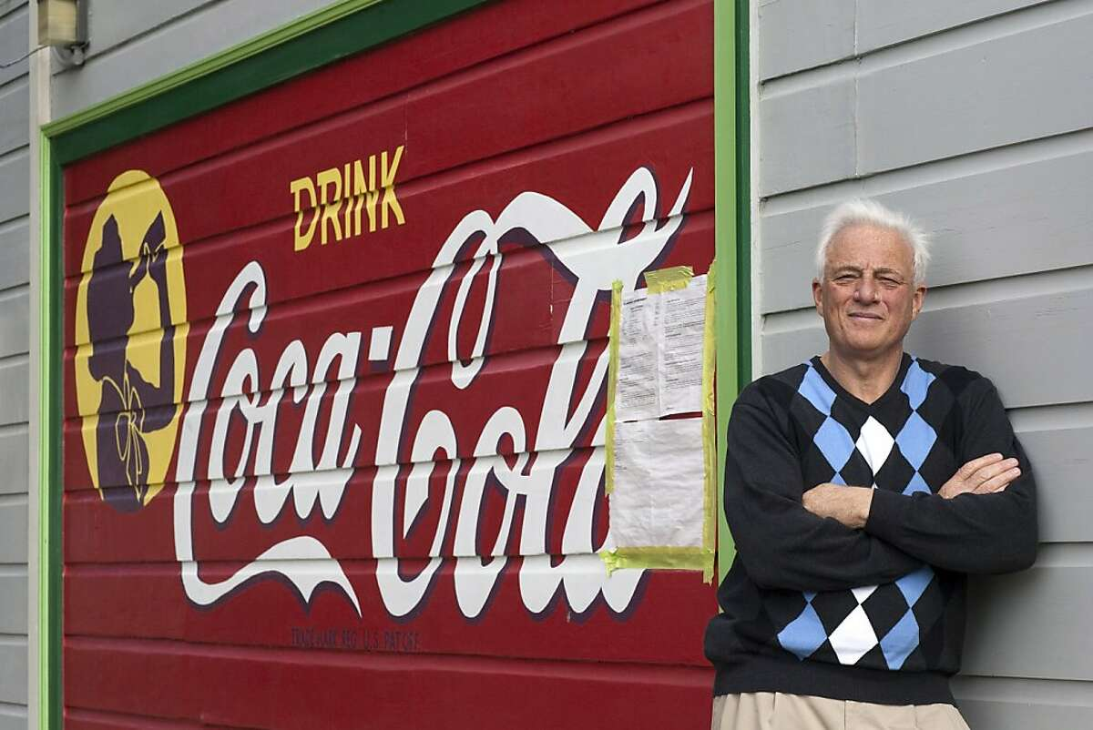 Richard Modolo stands in front of a Coca-Cola sign that was painted on the side of his house in the early 1950's when his home was the site of a mom and pop grocery store on February 23, 2011 in San Francisco, Calif. Photograph by David Paul Morris/Special to the Chronicle