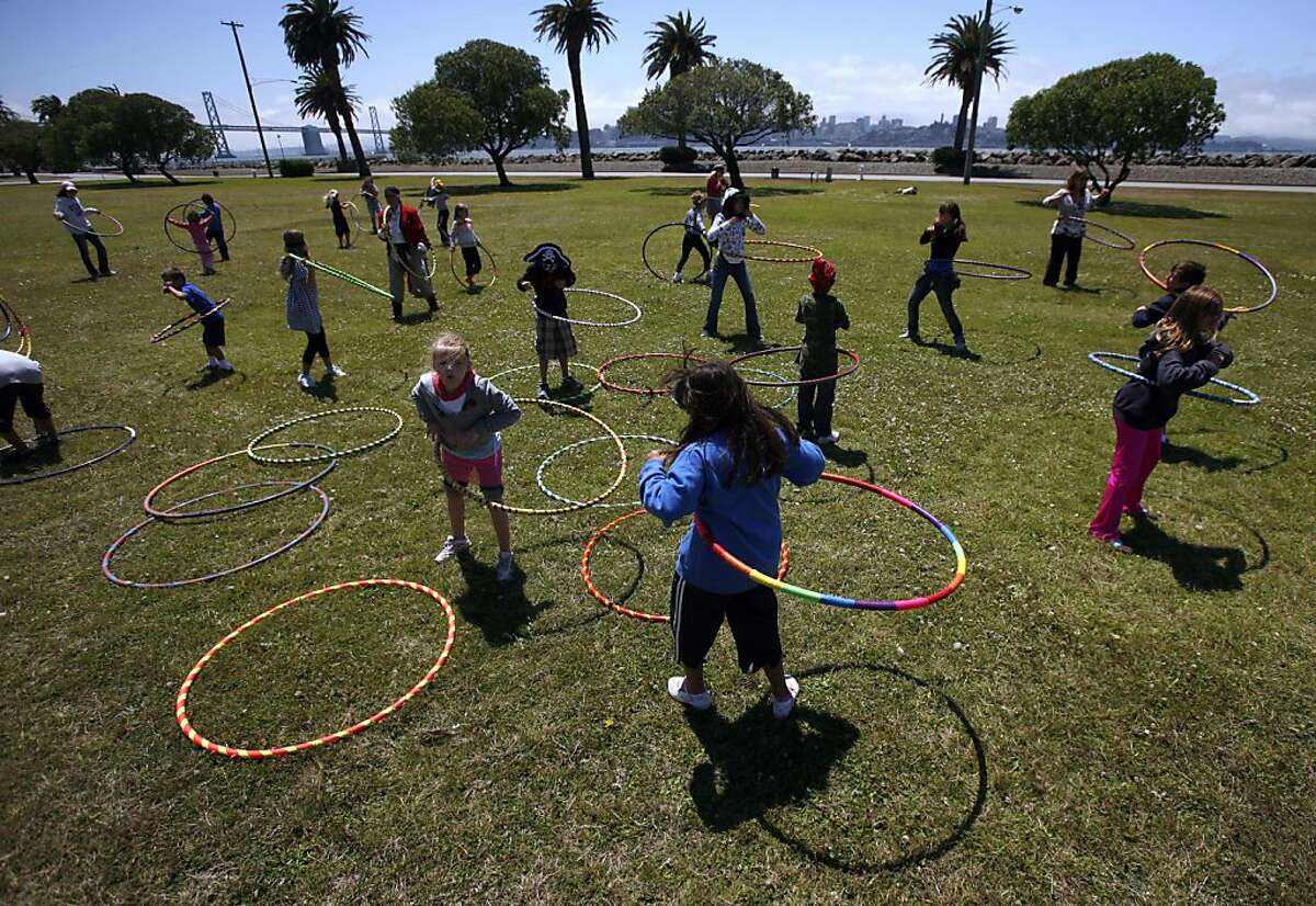 Hula hoop enthusiasts of all ages gather to celebrate