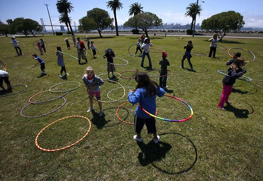 "Hula hoop enthusiasts of all ages gather to celebrate ""World Hoop Day"" on Thursday, Aug. 8, 2008 on Treasure Island near San Francisco, Calif. Photo: Kim Komenich, The Chronicle"