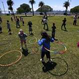 """Hula hoop enthusiasts of all ages gather to celebrate """"World Hoop Day"""" on Thursday, Aug. 8, 2008 on Treasure Island near San Francisco, Calif."""