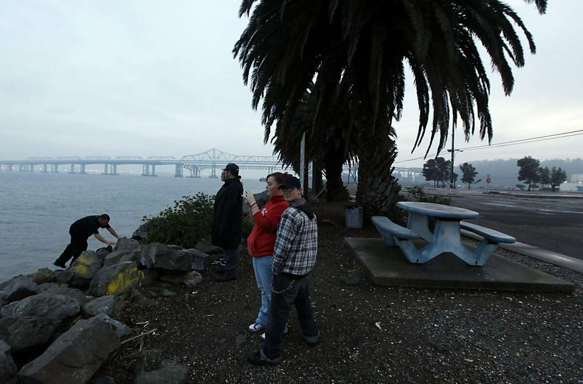Teens from Job Corp take a break from training to visit one of the picnic areas on the East side of Treasure Island. San Francisco Mayor Gavin Newsom struck a deal today with the U.S. Navy to transfer Treasure Island to San Francisco for a guaranteed payment of $55 million dollars plus additional considerations that could make the total deal worth more than $105 million. Wednesday Dec 16, 2009