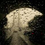Yes, I was drivng my car through the Treasure Island Tunnel making pictures, turned off the windshield wipers for a second to let the rain drops gather as I exited. Camera settings: Canon 1D MkIV, ISO 400, 1/250, f10, 50mm lens.