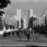 People walking along avenue at the Golden Gate International Exposition on Treasure Island in 1939.