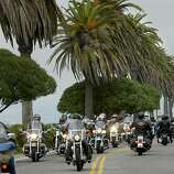 Hundreds of motorcyclists rode from Oakland to Treasure Island Sunday to raise money for the Muscular Dystrophy Assoc.--the ride took them by sensational views of San Francisco.