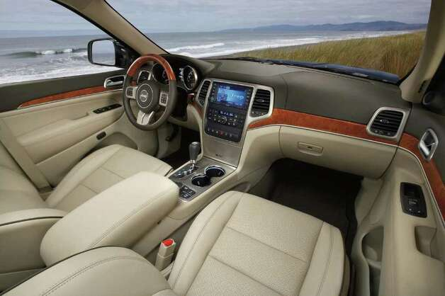 Premium leather and other amenities are included in the price of the 2012 Jeep Grand Cherokee Overland model, which is available with rear- or four-wheel drive. COURTESY OF CHRYSLER GROUP LLC Photo: Chrysler Group LLC., COURTESY OF CHRYSLER GROUP LLC