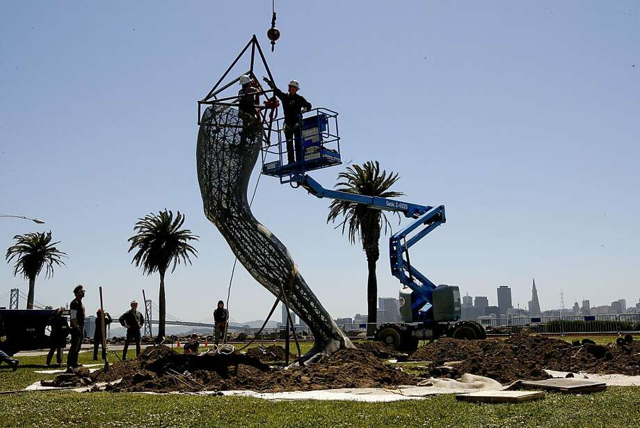 "The first of six pieces is moved into place as workers begin the installation of a forty foot tall metal sculpture by local artist Marco Cochrane along the waterfront on the west side of Treasure Island, in San Francisco, Ca.,  on Tuesday May 3, 2011. The art piece ""Bliss Dance"", was featured in the 2010 Burning Man celebration. They hope to complete work on the entire sculpture by end of day Thursday. Photo: Michael Macor, The Chronicle"