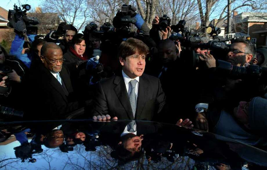 Former Illinois Gov. Rod Blagojevich departs his home in Chicago, Wednesday, Dec. 7, 2001, for the second day of his sentencing hearing on 18 corruption counts, including trying to to auction off President Barack Obama's old Senate seat.  (AP Photo/Charles Rex Arbogast) Photo: Charles Rex Arbogast / AP