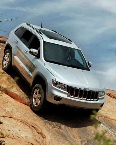 The Grand Cherokee is available with off-road-capable four-wheel drive and an air suspension for clearing obstacles on the trail. COURTESY OF CHRYSLER GROUP LLC Photo: Chrysler, COURTESY OF CHRYSLER GROUP LLC