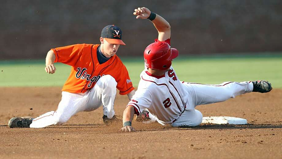 Virginia Keith Werman, left, tags out St. John's Joe Panik (2) at second base during Game 4 of the NCAA college regional baseball tournament on  Saturday, June 4, 2011, in Charlottesville, Va. Virginia won 10-2. Photo: Andrew Shurtleff, AP