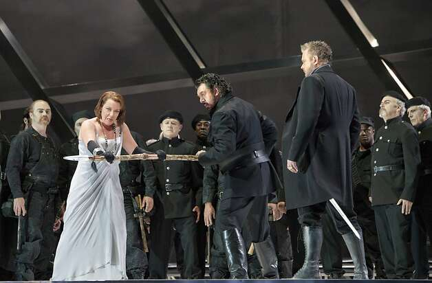 "Nina Stemme (Br?nnhilde), Andrea Silvestrelli (Hagen) and Ian Storey (Siegfried) with members of the San Francisco Opera chorus in ""Gotterdammerung"" Photo: Cory Weaver, San Francisco Opera"