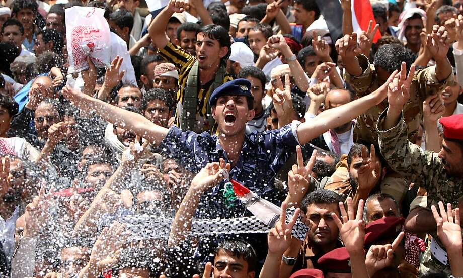 Yemeni anti-government protesters gather in Sanaa on June 5, 2011 to celebrate what they said was the fall of Yemen's regime after embattled President Ali Abdullah Saleh, wounded in a blast, left the country for medical treatment in Saudi Arabia. Photo: -, AFP/Getty Images