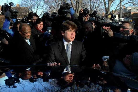 Former Illinois Gov. Rod Blagojevich departs his home in Chicago, Wednesday, Dec. 7, 2001, for the second day of his sentencing hearing on 18 corruption counts, including trying to to auction off President Barack Obama's old Senate seat.  (AP Photo/Charles Rex Arbogast)