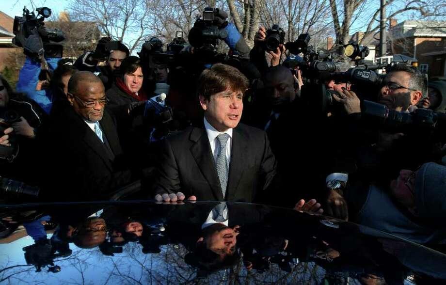 El ex gobernador de Illinois Rod Blagojevich sale de su casa en Chicago, el miércoles 7 de diciembre de 2011, hacia la audiencia judicial en la que recibió su sentencia bajo cargos de corrupción. Photo: Charles Rex Arbogast / AP