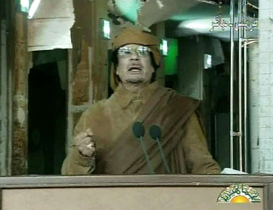 This image broadcast on Libyan state television Tuesday, Feb. 22, 2011, shows Libyan leader Moammar Gadhafi as he addresses the nation in Tripoli, Libya. Libya's Gadhafi vowed to fight on against protesters demanding his ouster and die as martyr. Photo: AP