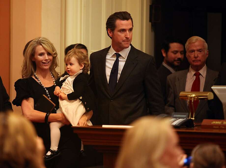 Mayor Gavin Newsom arrives with his wife Jennifer Siebel and daughter to get  sworn in as lieutenant governor by his father, Hon. Judge William Newsom (far right) at the state capitol in Sacramento, Calif., on Monday, January 10, 2011. Photo: Liz Hafalia, The Chronicle