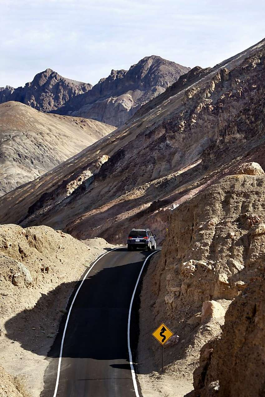 Death Valley is a park that bears the most fruit for those in cars. Exhibit A: Artist's Drive, a nine-mile cruise through colorful rock formations and curves that will make you catch your breath. The one-lane loop is only open to cars under 25 feet.