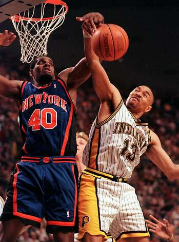 Indiana Pacers guard Mark Jackson (13) and New York Knicks' Kurt Thomas battle for a rebound in the fourth quarter in the second game of the Eastern Conference Championship in Indianapolis Tuesday, June 1, 1999. Jackson lead the Pacers with 17 points as the Pacers defeated tghe Knicks 88-86.