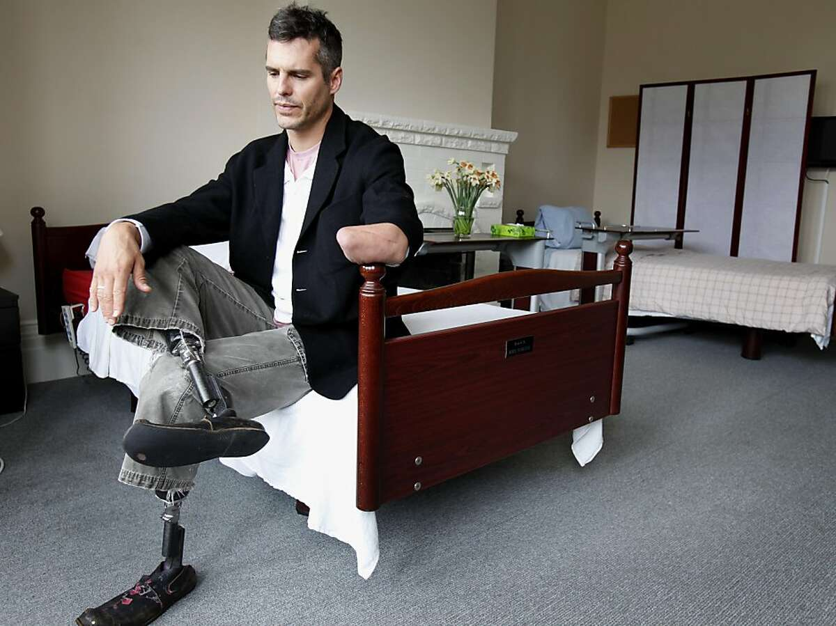 Dr. BJ Miller sits on a patients bed at the Zen Hospice Project Tuesday May 17, 2011. Dr. BJ Miller, an expert in palliative care at UCSF, has become head of the Zen Hospice Project in San Francisco, Calif. Miller lost three of his limbs in his youth, an experience which lead him to a medical career.