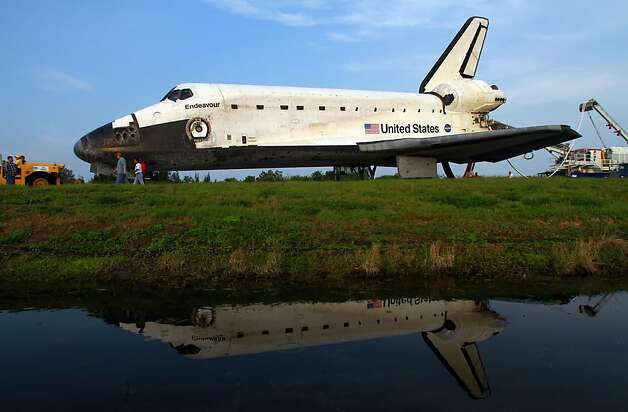 The space shuttle Endeavour, STS-134, is towed to an orbitor processing facility after safely landing on its final mission on Wednesday, June 1, 2011, at Kennedy Space Center in Florida. (Red Huber/Orlando Sentinel/MCT) Photo: Red Huber, MCT