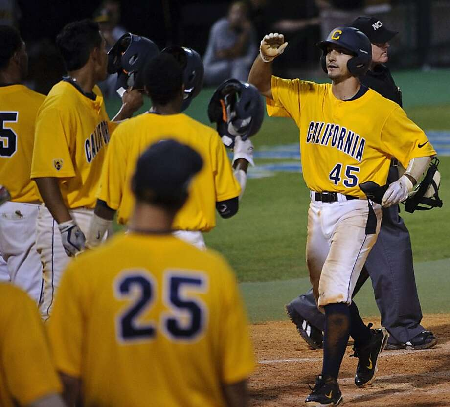 California's Chad Bunting (45) is congratulated after hitting a three-run home run during the eighth inning of an NCAA regional college baseball game against Baylor, Sunday, June 5, 2011, in Houston. Photo: Dave Einsel, AP
