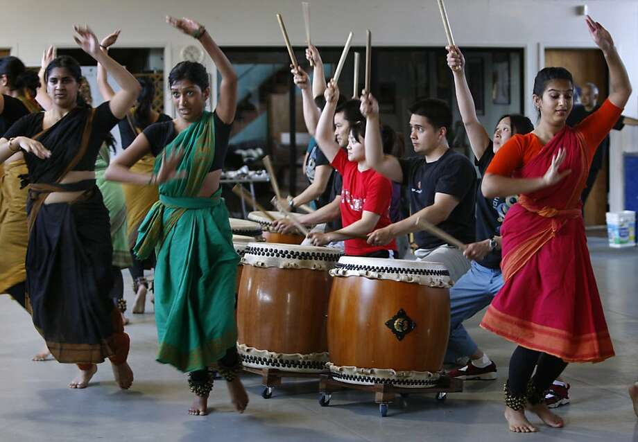 "Drummers from San Jose Taiko and dancers with the Abhinaya Dance Company rehearse in San Jose, Calif. on Saturday, May 21, 2011, for a collaborative performance, ""Synergy"", which will open the Ethnic Dance Festival at Zellerbach Hall in Berkeley on June 11. Photo: Paul Chinn, The Chronicle"