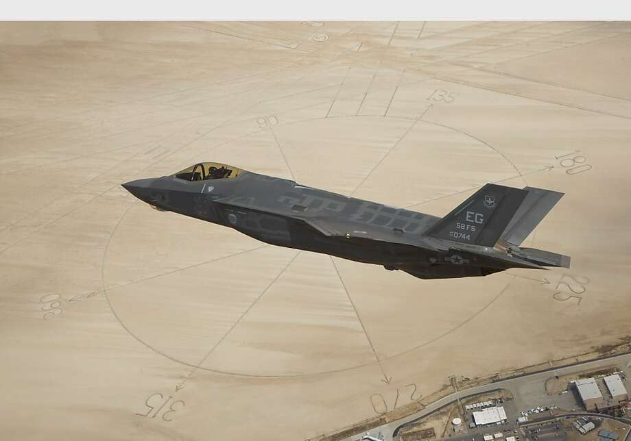The second Lockheed Martin F-35A Lightning II production aircraft flies above the compass rose of Rogers Dry Lakebed at Edwards Air Force Base, Calif. The aircraft, designated AF-6, ferried to Edwards AFB from Naval Air Station Fort Worth Joint Reserve Base following the Air Force formally accepting the fighter into its inventory. Photo: Paul Weatherman, PR Newswire