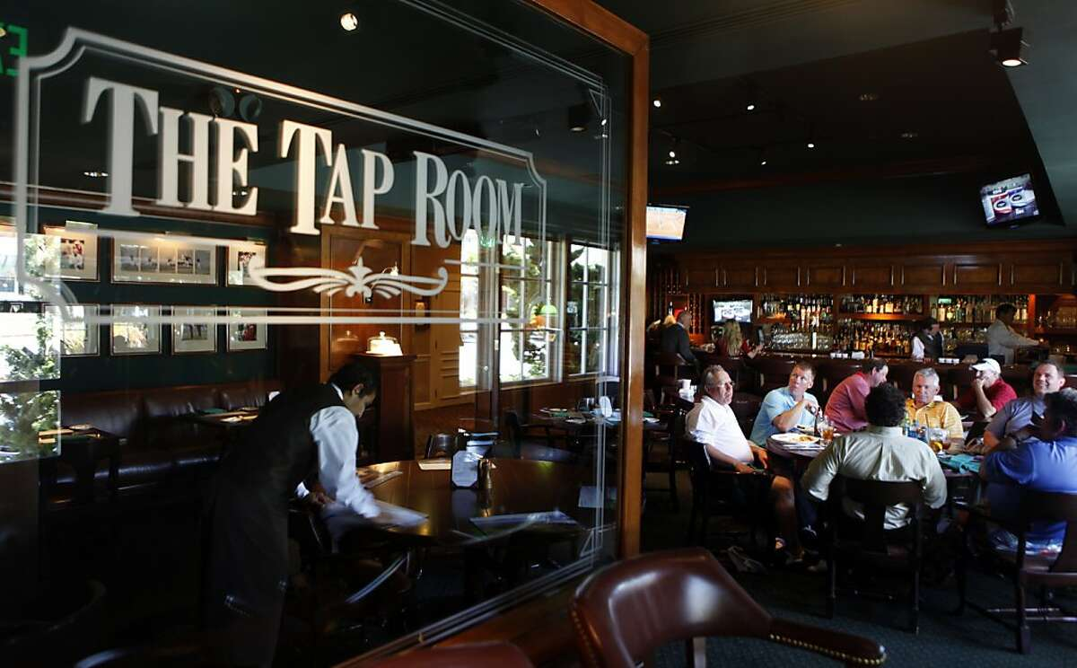 Golfers relax in Pebble Beach Lodge Tap Room after a round on the famous course Thursday, May 5, 2011.