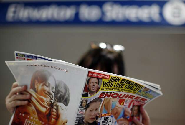 A commuter reads a copy of the National Enquirer headlining a story on former Democratic presidential candidate John Edwards having an extramarital affair while his wife was battling cancer. Photo: Ed Ou, AP