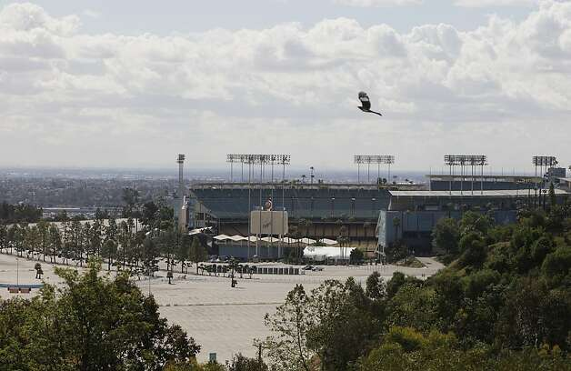 The Los Angeles Dodger stadium is seen from Elysian Park, Friday, April, 8, 2011. Bryan Stow, a 42-year-old San Francisco Giants fan, was severely beaten in the Dodgers' stadium parking lot after the team's home opener last week. He remains in critical condition showing signs of brain damage. Photo: Damian Dovarganes, AP