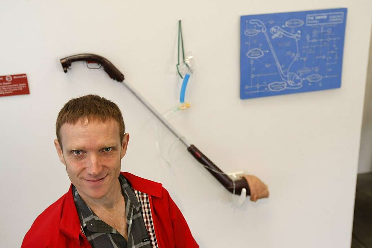 Scott Kildall, one of three artists-in-residence at Recology, stands in front of his
