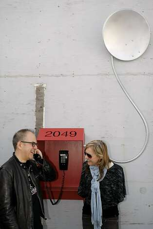"Gene Michal (left) and Deborah Munk (right) question a person from the future in the year 2049, by way of Scott Kildall's ""2049 Hotline"" installation piece. Kildall is one of three artists-in-residence at Recology, displaying work made from scavenging materials from the dump for four months at San Francisco Recology in San Francisco, Calif., on Friday, May 20 2011. Photo: Thomas Levinson, The Chronicle"