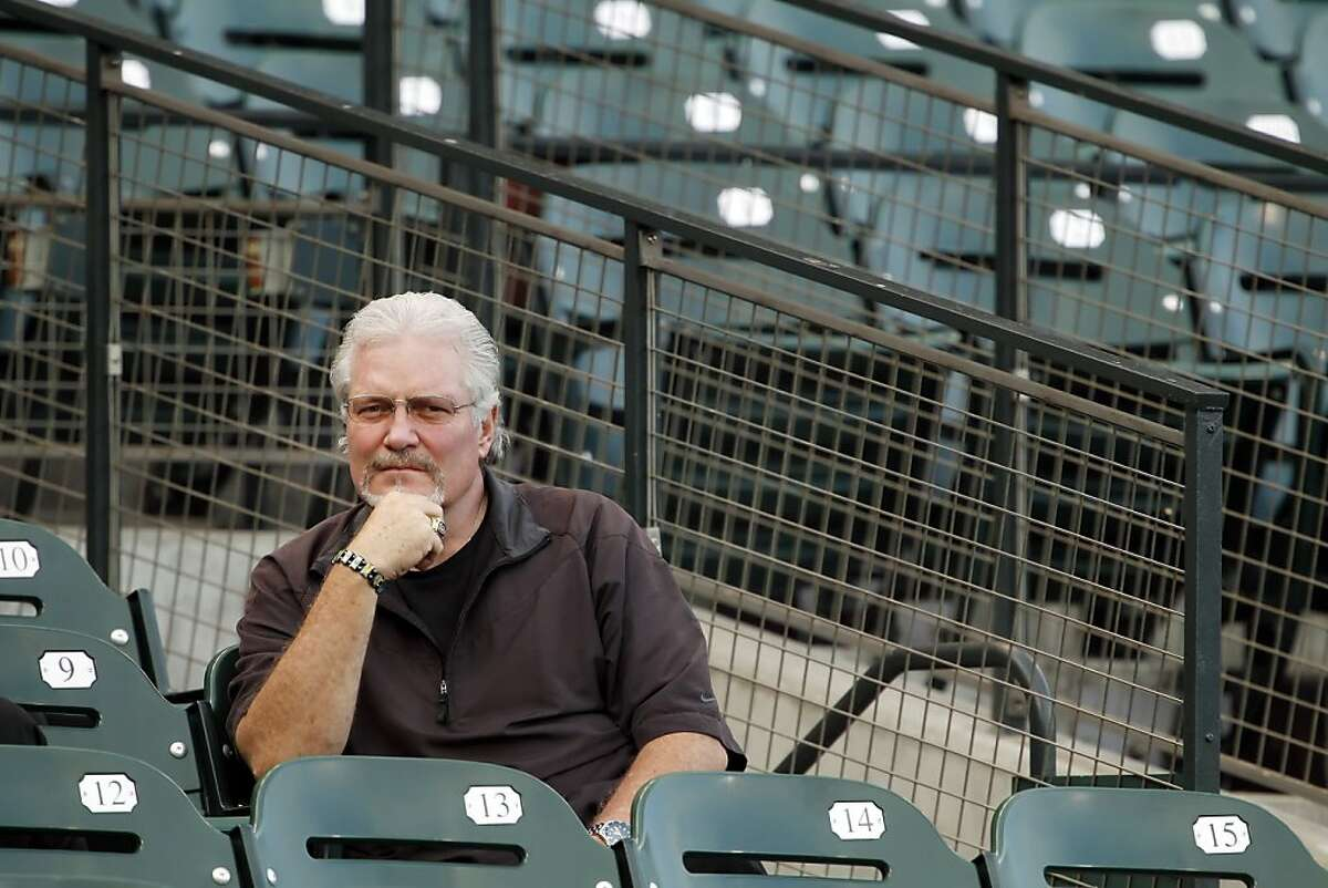 Giants general manager, Brian Sabean, watches the team work out from the stands. The San Francisco Giants practiced AT&T Park in San Francisco, Calif., on Tuesday, October 5, 2010, in preparation for their National League Division Series against the Atlanta Braves.
