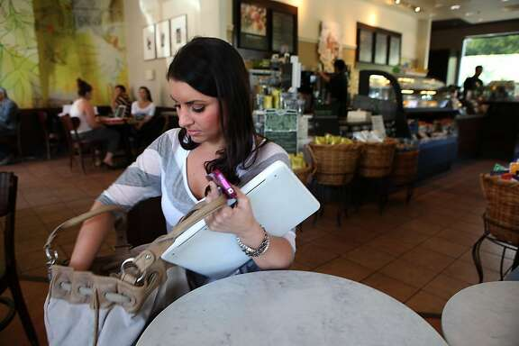Jenna Maiorino is a student at Foothill Community College, prepares to leave after taking a Math 105 online at a Starbucks in Mountain View, Calif., on Wednesday,  June 1, 2011.  There is apparently an improper fee being charged by some community colleges for access to online classes.