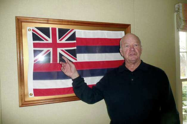 Greenwich resident Norman Burger, a Hawaiian native, was nine years old when the Japanese bombed Pearl Harbor. Here Burger stands before his state flag of Hawaii, which has eight stripes for the eight Hawaiian Islands and the British Union Jack, representing Hawaii's historical relationship with Great Britain. Hawaii was a protectorate of England dating back to 1778 when the islands were discovered by British explorer Capt. James Cook. Photo: Anne W. Semmes