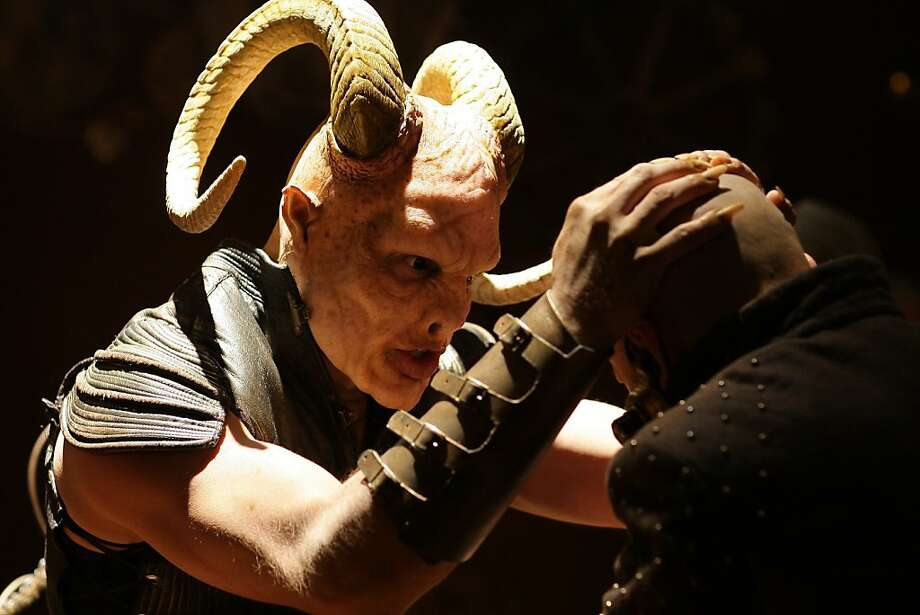 """Beelzebub (Bjorn Geske) grapples with Mr. Wu (Haining Luan) in Ralph Hyver's """"Red Ice,"""" playing at the 2011 Another Hole in the Head Film Festival. Photo: Another Hole In The Head"""