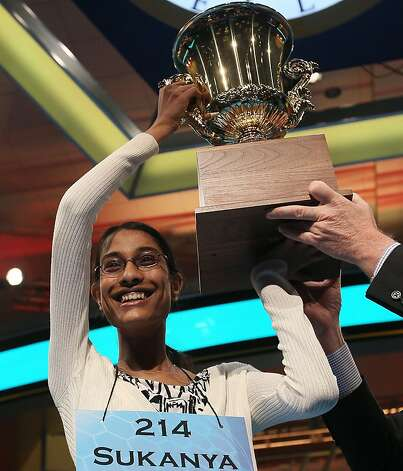 Sukanya Roy of South Abington Township, Pennsylvania holds up the trophy after winning the 2011 Scripps National Spelling Bee competition June 2, 2011 in National Harbor, Maryland. Spellers participated in the annual competition to win the national title. Photo: Mark Wilson, Getty Images