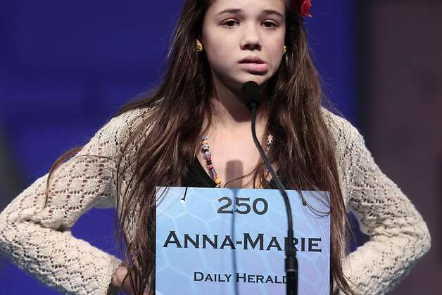 Anna-Marie Mitroi Sprenger, 13, from Provo, Utah, pauses before spelling 'limacine' correct during the semifinals of the 2011 Scripps National Spelling Bee at the Gaylord National Resort and Convention Center in National Harbor, Md., Thursday, June 2, 2011. Photo: Pablo Martinez Monsivais, AP