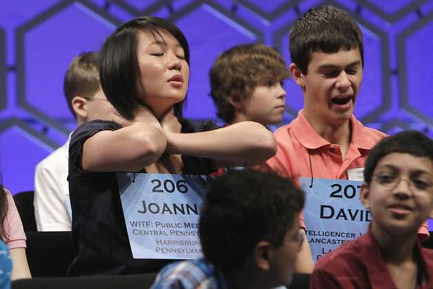 Joanna Z. Ye, 14, Harrisburg, Pa., left, stretches as David Krak, 15, from Lancaster, Pa., yawns, during a two minute break in competition during the semifinals of the National Spelling Bee, in National Harbor, Md., Thursday, June 2, 2011. Photo: Jacquelyn Martin, AP