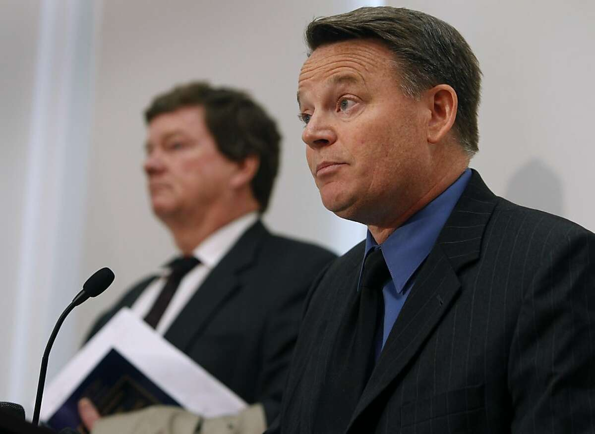 Contra Costa County district attorney Mark Peterson (right) announces at a news conference in Martinez, Calif. on Friday, June 3, 2011, that federal investigators are joining the probe into the corruption case involving four police officers. Senior deputy district attorney Harold Jewett (left) listens to the announcement.