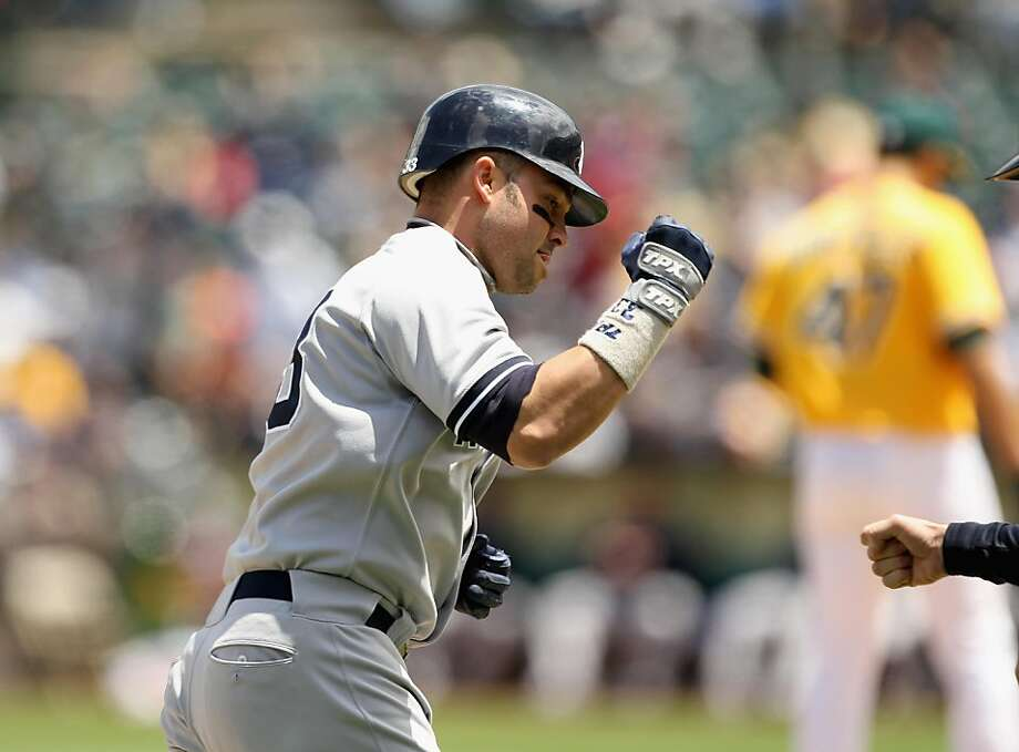 OAKLAND, CA - JUNE 01:  Nick Swisher #33 of the New York Yankees rounds the bases after he hit a three run home run in the fourth inning against the Oakland Athletics at Oakland-Alameda County Coliseum on June 1, 2011 in Oakland, California. Photo: Ezra Shaw, Getty Images