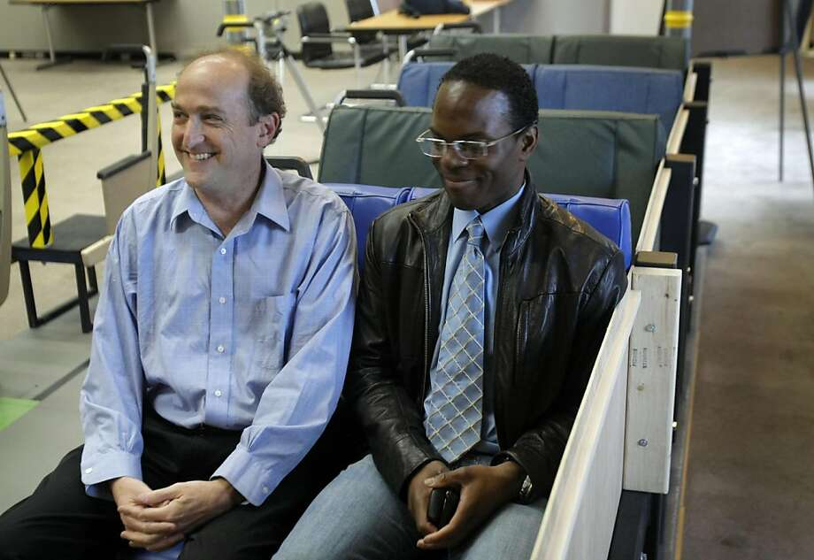 BART Board of Directors President Bob Franklin (left) and spokesman Linton Johnson try potential new BART train seats during a media preview of the mobile seating lab at Joseph Bort Metrocenter in Oakland on Sunday, April 24. Photo: Thomas Levinson, The Chronicle