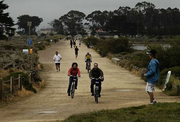 People enjoy a walk, bike or run along the shoreline path that runs the length of Crissy Field, in San Francisco, Ca., on Friday May 27, 2011, as the recreation area gets ready to celebrate the 10th anniversary of it's restoration. Photo: Michael Macor, The Chronicle