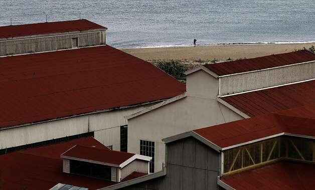 A fisherman is framed by a group of the old Presidio buildings at Crissy Field, in San Francisco, Ca., on Friday May 27, 2011, as the recreation area gets ready to celebrate the 10th anniversary of it's restoration. Photo: Michael Macor, The Chronicle