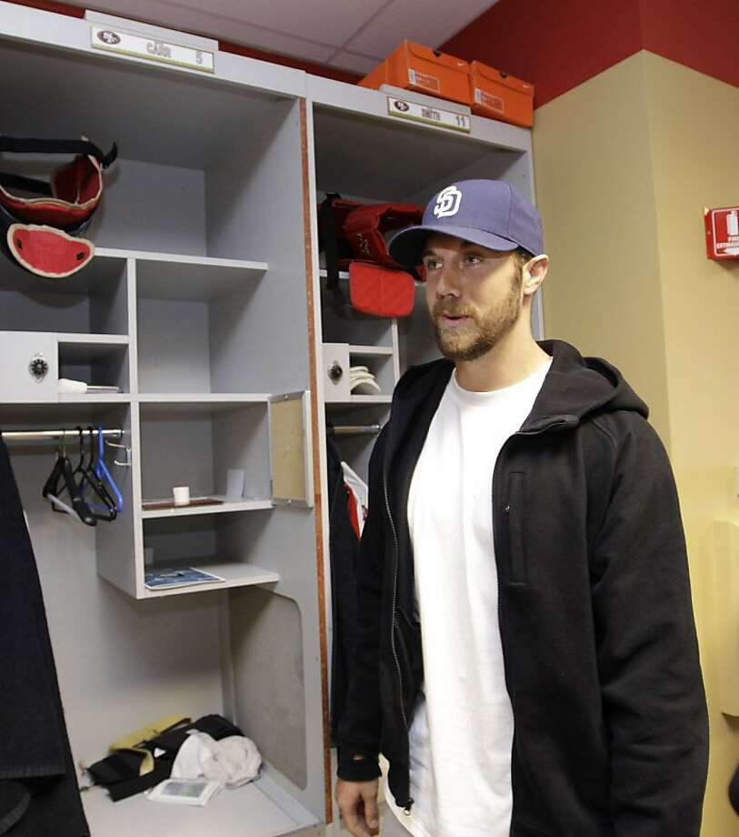 San Francisco 49ers quarterback Alex Smith cleans out his locker at 49ers NFL football headquarters in Santa Clara, Calif., Monday, Jan. 3, 2011. Photo: Paul Sakuma, AP
