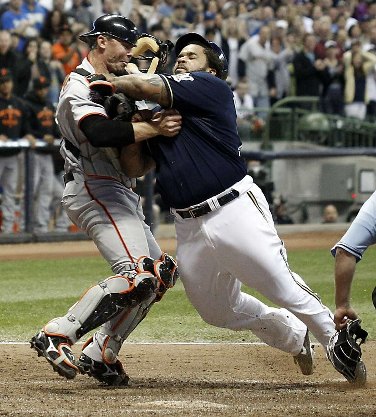 Milwaukee Brewers' Prince Fielder, right, is tagged out by San Francisco Giants catcher Eli Whiteside, left, while trying to score during the eighth inning of a baseball game Friday, May 27, 2011, in Milwaukee.