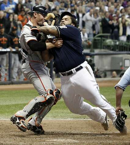 Milwaukee Brewers' Prince Fielder, right, is tagged out by San Francisco Giants catcher Eli Whiteside, left, while trying to score during the eighth inning of a baseball game Friday, May 27, 2011, in Milwaukee. Photo: Morry Gash, AP