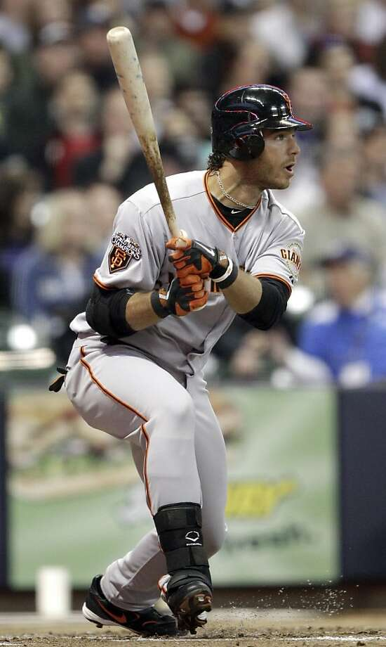 **CORRECTS NAME TO BRANDON CRAWFORD NOT CHRIS STEWART** San Francisco Giants' Brandon Crawford watches his fly ball out to Milwaukee Brewers right fielder Nyjer Morgan during the third inning of a baseball game Friday, May 27, 2011, in Milwaukee. Photo: Morry Gash, AP