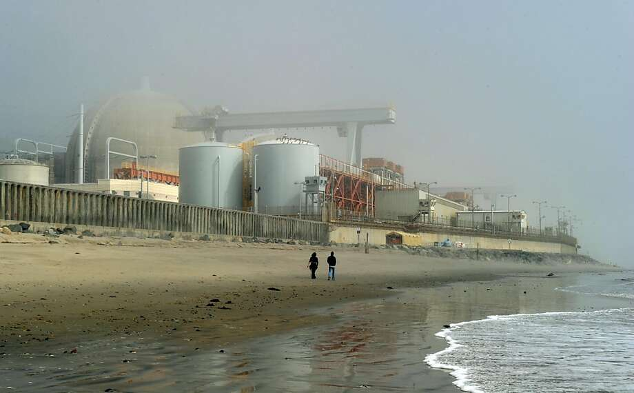 "People walk through sea mist beside the San Onofre Nuclear Power Plant in north San Diego County on March 15, 2011.  The San Onofre Nuclear Power Plant sits at the edge of the Pacific Ocean on a  84-acre site between San Diego and Orange County and provides much of Southern California its power. US Energy Secretary Steven Chu assured lawmakers worried about quake-hit Japan's nuclear crisis that US atomic facilities had ""rigorous"" safety measures that anticipate major natural disasters. ""The American people should have full confidence that the United States has rigorous safety"" rules and that nuclear plant builders ""clearly consider things like tsunamis ... and earthquakes,"" Chu told a key congressional committee. Photo: Mark Ralston, AFP/Getty Images"
