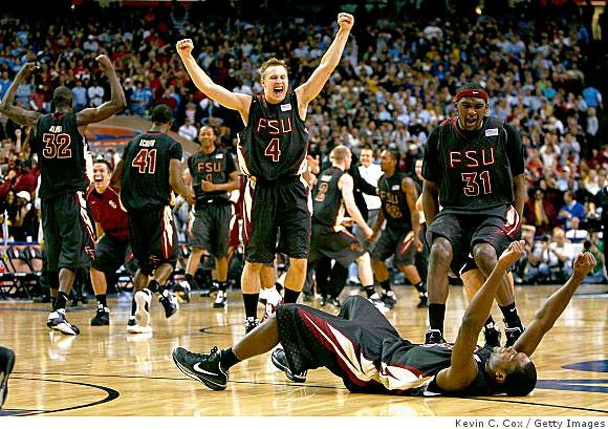ATLANTA - MARCH 14: Deividas Dulkys #4 and Chris Singleton #31 of the Florida State Seminoles rush the floor to celebrate with Toney Douglas #23 after defeating the North Carolina Tar Heels 73-70 during the semifinals of the 2009 ACC Men's Basketball Tournament on March 14, 2009 at the Georgia Dome in Atlanta, Georgia. (Photo by Kevin C. Cox/Getty Images)