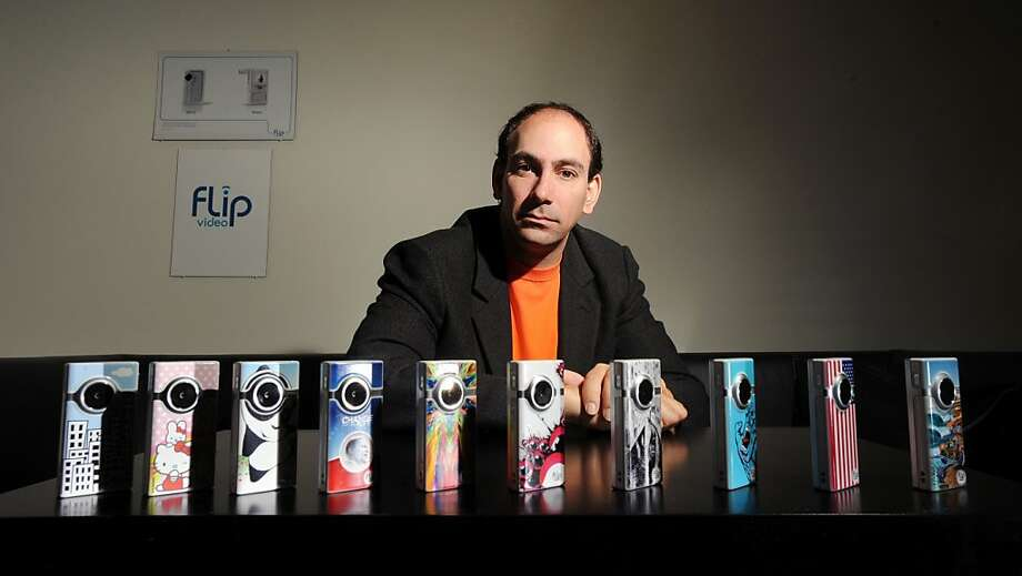 Pure Digital CEO Jonathan Kaplan sits behind a row of his company's video recorders on Monday, Nov. 24, 2008, in San Francisco. Photo: Noah Berger, Special To The Chronicle